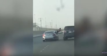Video: Man Leans Out of His Car on Highway For Fist Fight & Gets Served